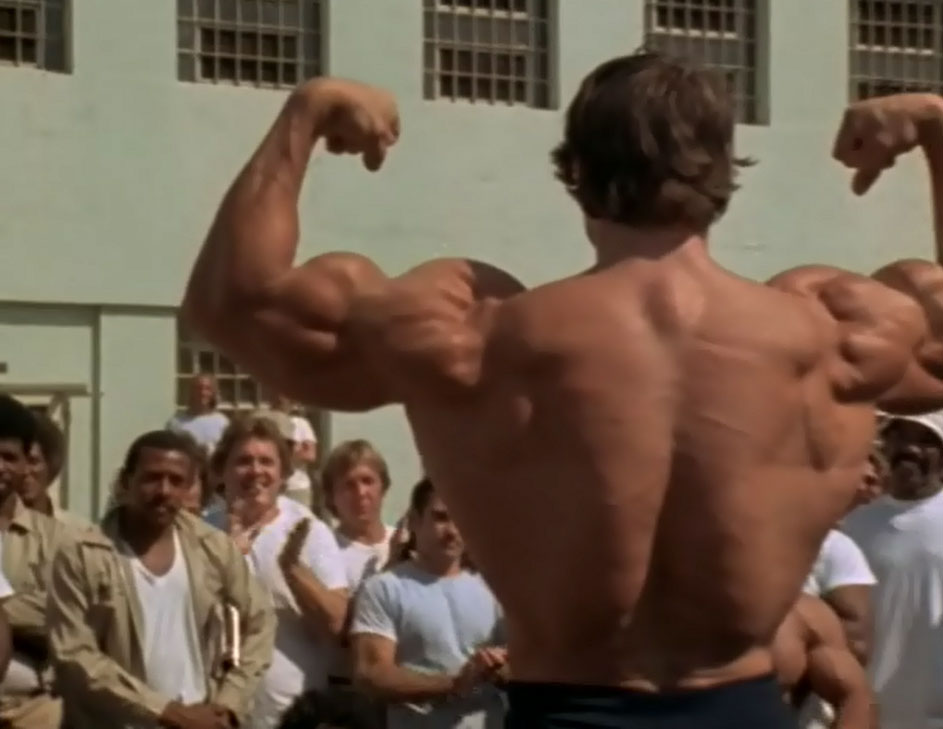 Arnie Back Double Biceps Pose in Jail