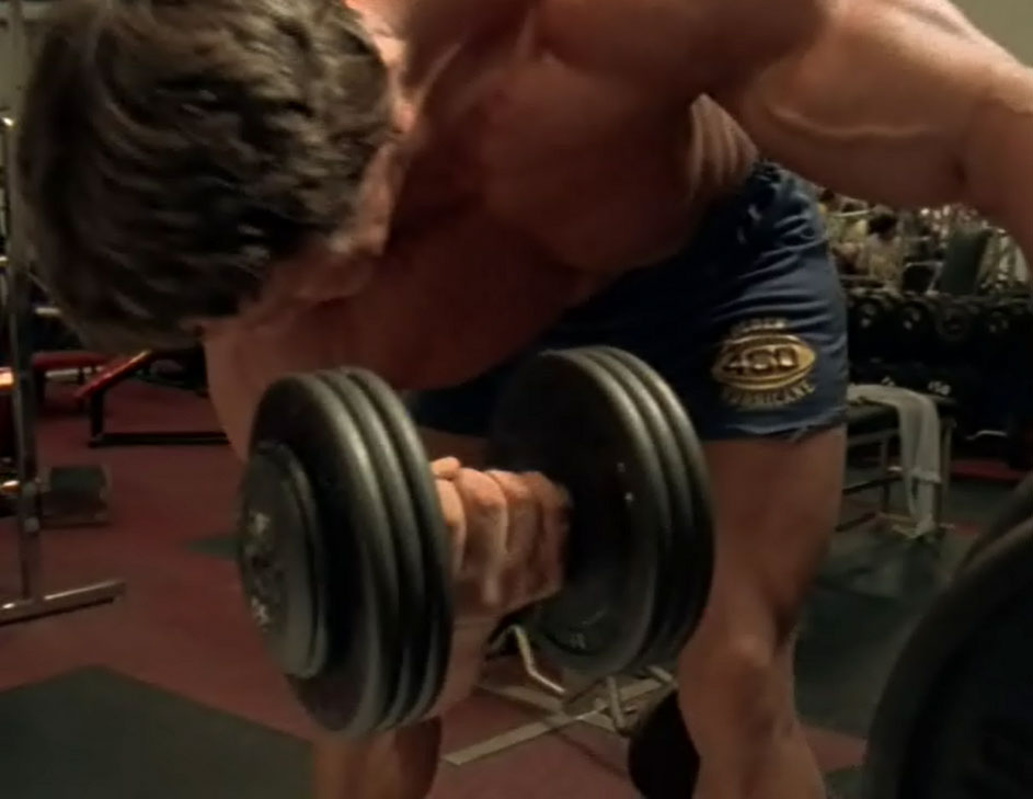 Arnie Doing Bicep Curls - Showing Dumbbell Plates