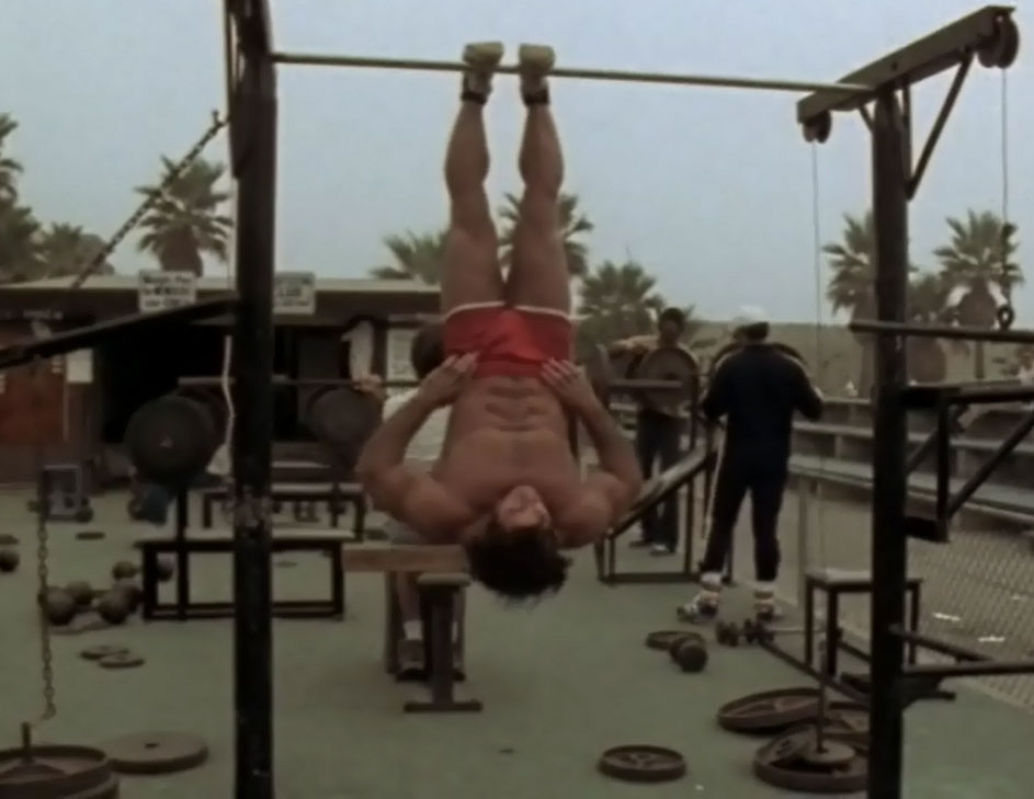 Franco Columbu Doing Crunches Hanging Upside Down